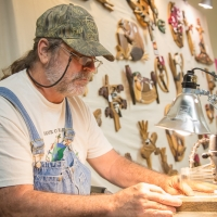 Craftsman at the Audubon Art and Craft Festival (Hawley, PA). Photo credit: Chris Fischer.